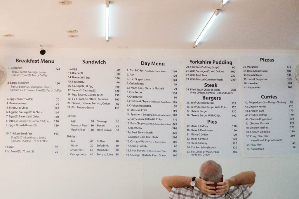 Menu on wall at Take Away Restaurant
