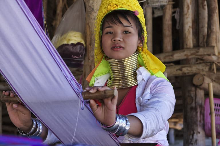 Photo of girl with gold rings around her neck from the Long Neck tribe in Chiang Mai Thailand.