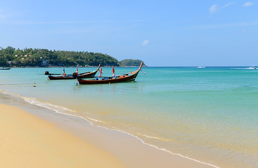 Two boat in the ocean at Karon Beach in Phuket Thailand.