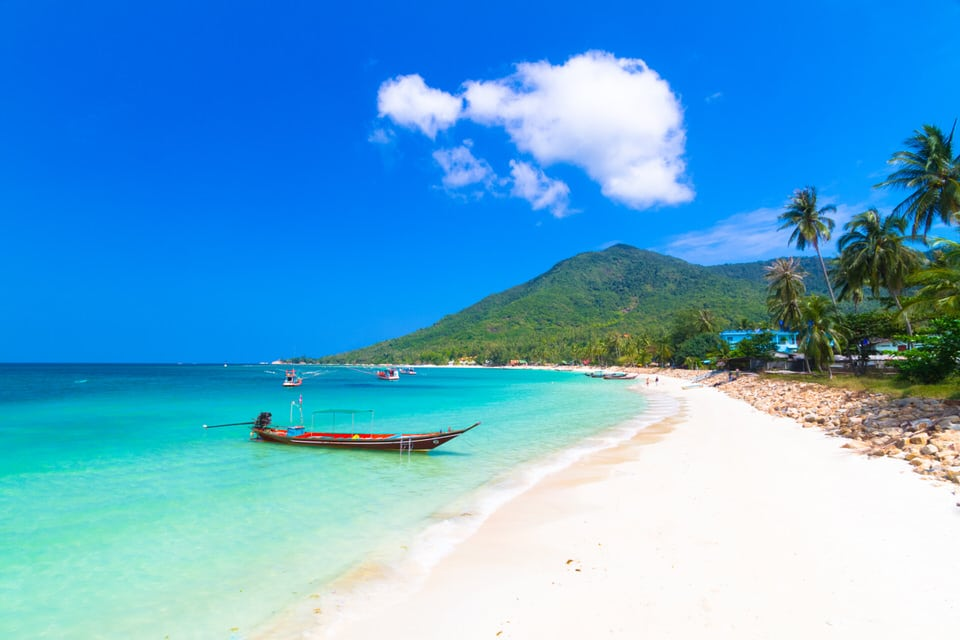 White sand and blue waters of Ko Pha Ngan Thailand.