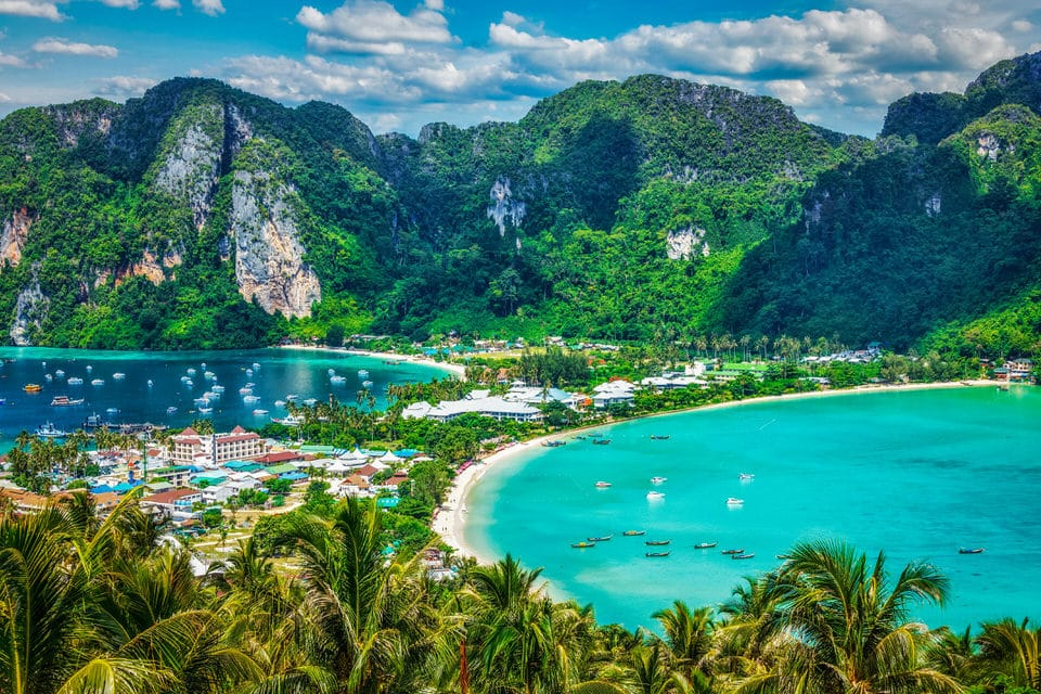 Photo of beach and mountains on Ko Phi Phi island, Thailand.